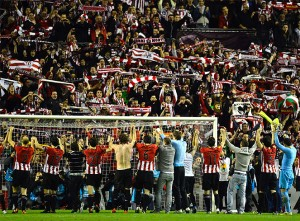 Athletic Bilbao's players celebrate after victory over Sporting in their Europa League semi-final second leg soccer match at San Mames stadium in Bilbao