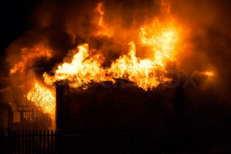 6748375-burning-fire-flame-on-wooden-house-roof
