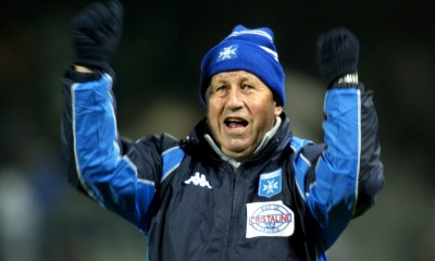 Guy Roux, coach of French team Auxerre waves at the crowd after his team defeated [Dutch team Utrech..